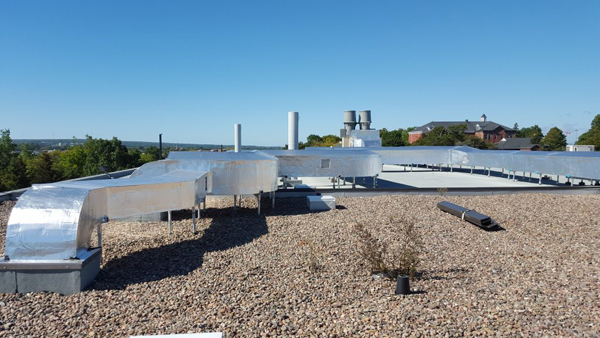 Rooftop ductwork from existing fume hoods to new Greenheck exhaust fans
